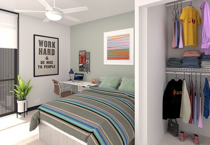Model bedroom with ceiling fan, light, desk and bed