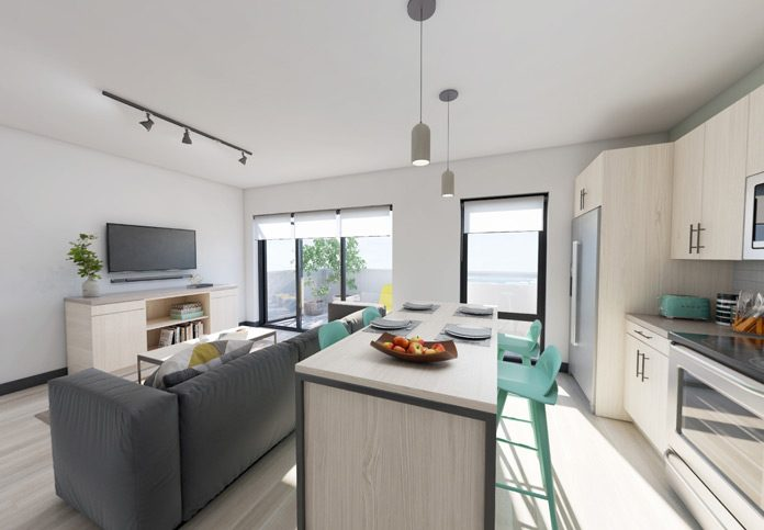 Kitchen overlooking living room and balcony windows